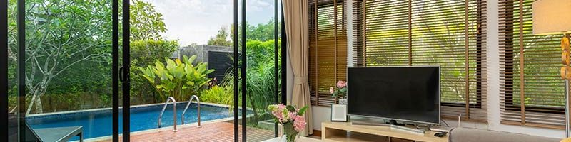 stunning-pool-view-from-a-living-room-in-luxury-villa_t20_2wZK4P-1.jpg